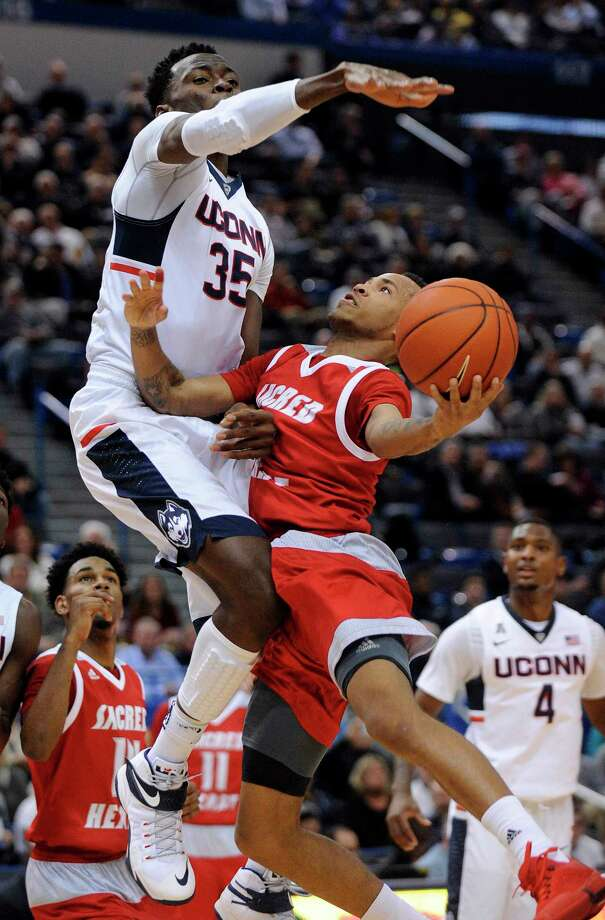 Connecticut's Amida Brimah (35) guards Sacred Heart's Cane Broome during the first half Wednesday. Photo: Fred Beckham — The Associated Press   / FR153656 AP