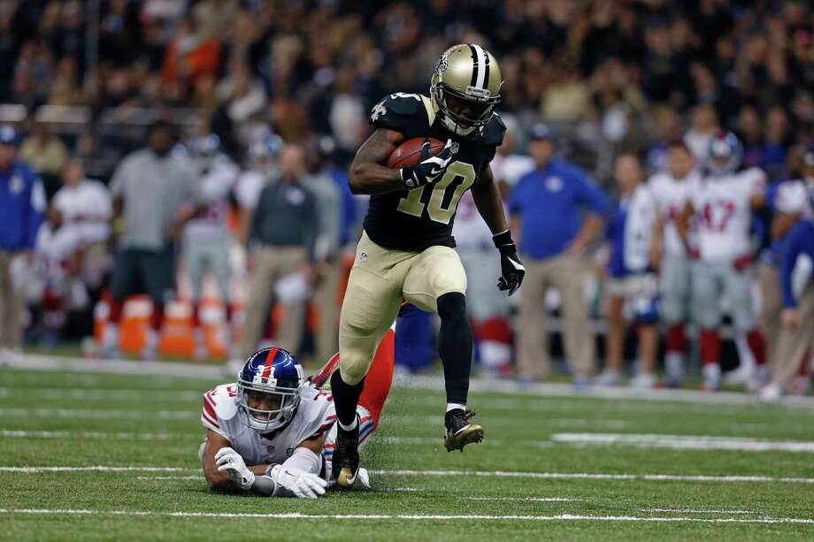 Saints receiver Brandin Cooks runs past New York Giants defensive back Trevin Wade during Sunday's game in New Orleans. Photo: Jonathan Bachman — The Associated Press   / FR170615 AP