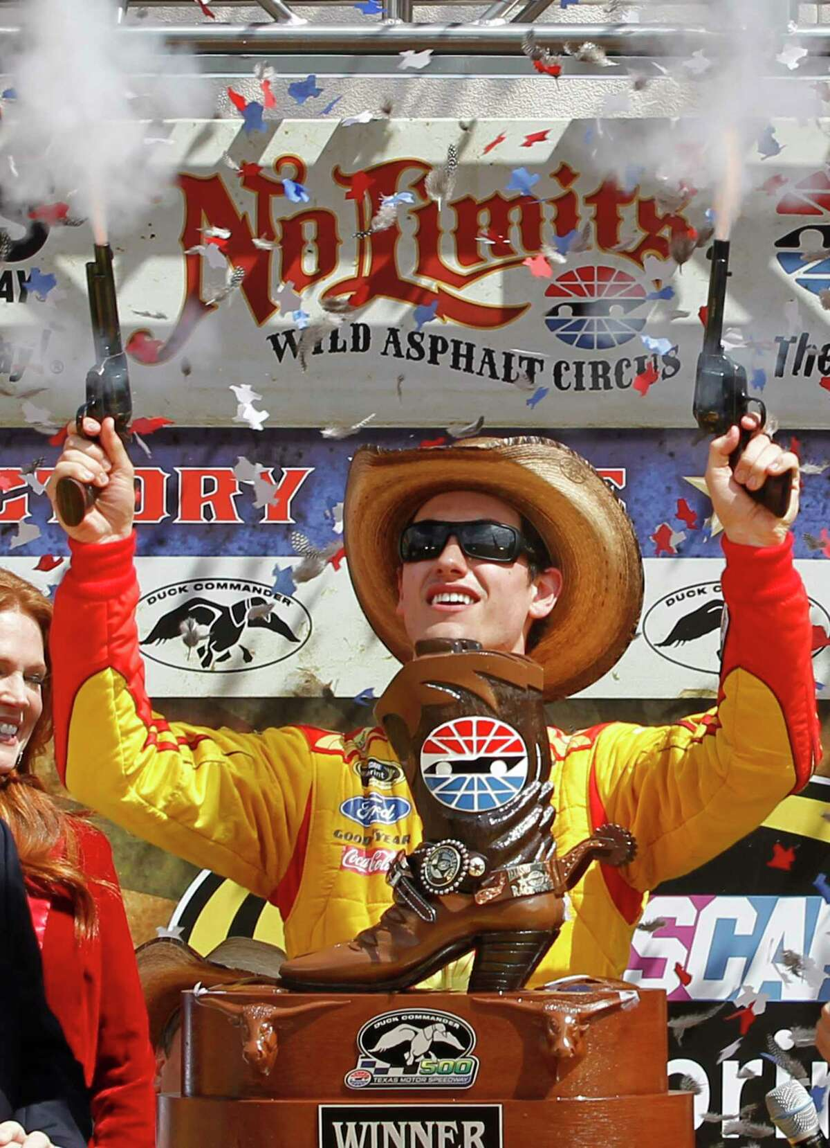 In this April 7, 2014 file photo, Joey Logano shoots off pistols celebrating winning the NASCAR Sprint Cup race at Texas Motor Speedway in Fort Worth.
