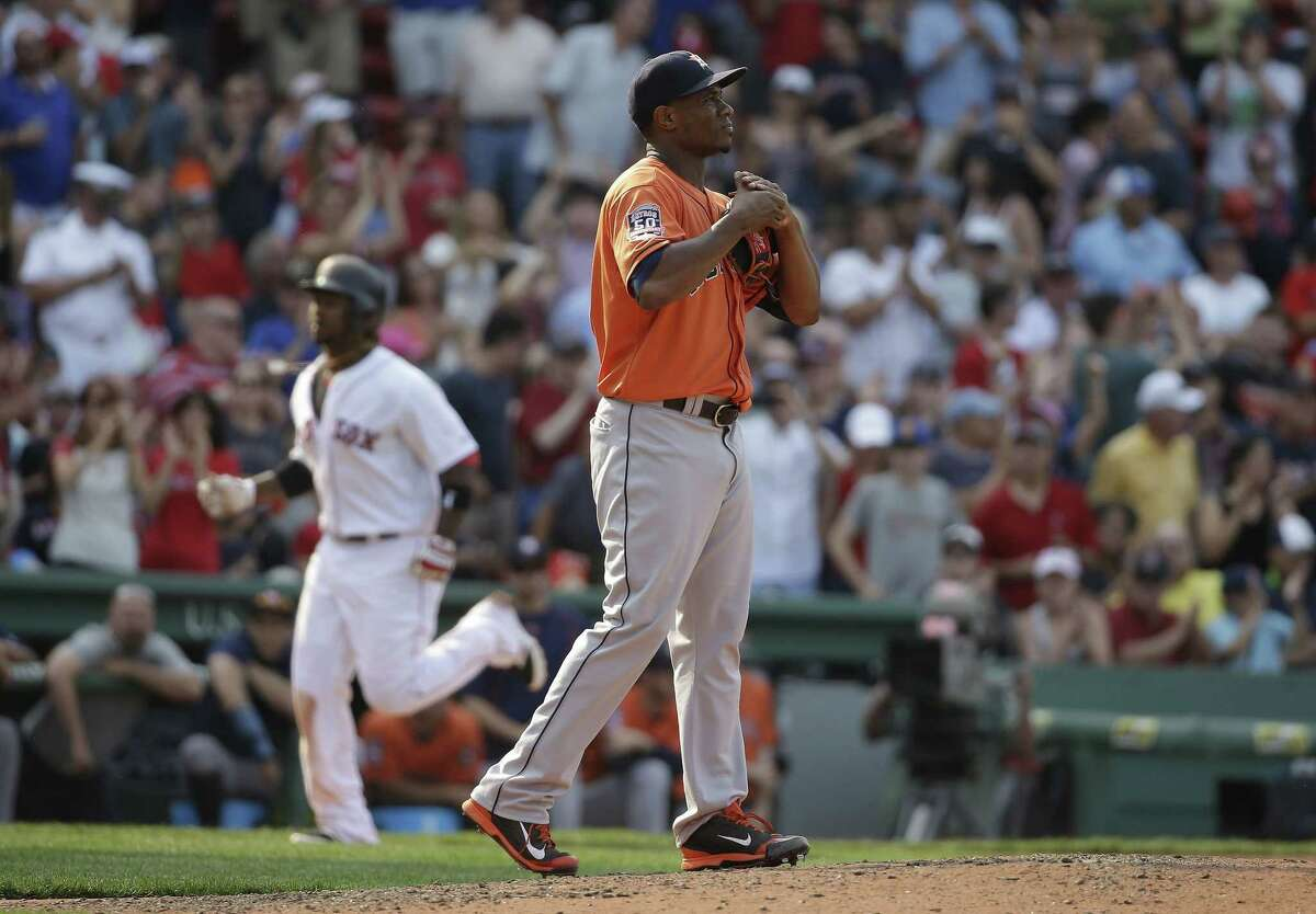 Boston Red Sox's Hanley Ramirez runs the bases toward home after hitting a two-run home run off a pitch by Houston Astros relief pitcher Tony Sipp, right, in the seventh inning of a baseball game against the Houston Astros at Fenway Park, Sunday, July 5, 2015, in Boston. The Red Sox won 5-4. (AP Photo/Steven Senne)