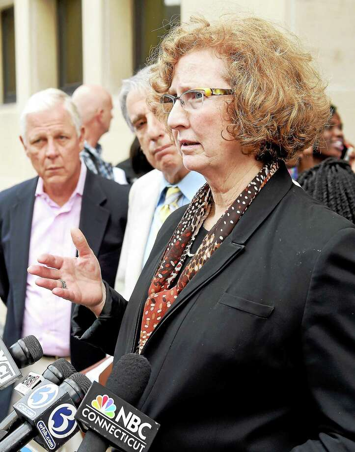 Darcy McGraw, executive director of the Connecticut Innocence Project, speaks to the press outside Superior Court in New Haven about another case. Photo: Arnold Gold — New Haven Register