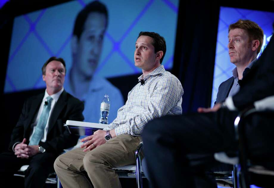 Jason Robins, center, CEO of DraftKings website, speaks on a panel at the Global Gaming Expo in Las Vegas. Photo: The Associated Press   / AP