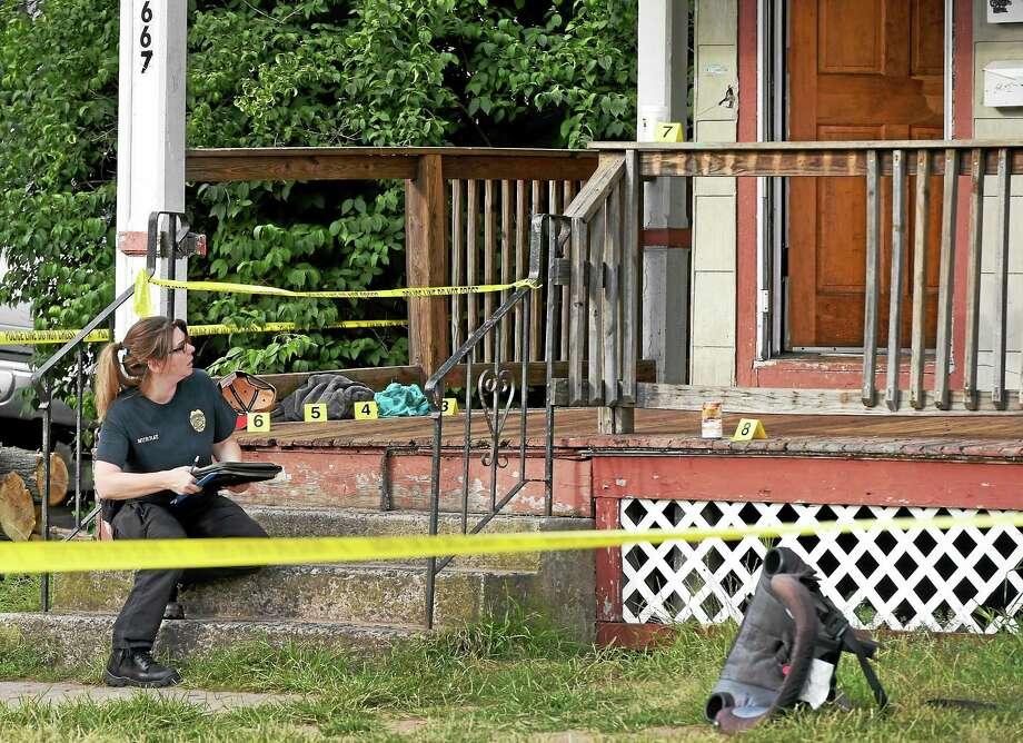 West Haven Police investigate a shooting at 667 Washington Ave. near Elm Street in West Haven Thursday. Photo: Peter Hvizdak — New Haven Register   / ©2015 Peter Hvizdak