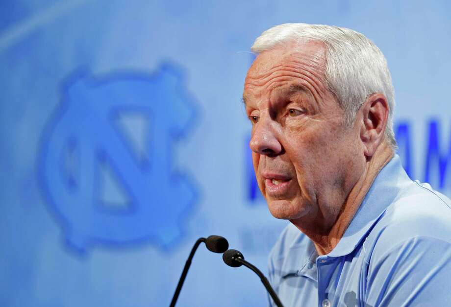 North Carolina coach Roy Williams answers a question during the ACC media day on Wednesday in Charlotte, N.C. Photo: Chuck Burton — The Associated Press   / AP
