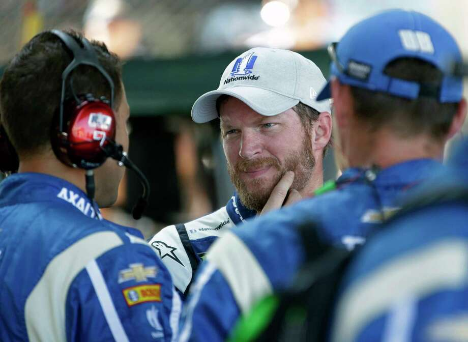 Dale Earnhardt Jr. (88) talks with his crew after dropping out of the NASCAR Brickyard 400 auto race at Indianapolis Motor Speedway in Indianapolis, Sunday, July 23, 2017. (AP Photo/AJ Mast) ORG XMIT: NAA116 Photo: AJ Mast / FR123854 AP