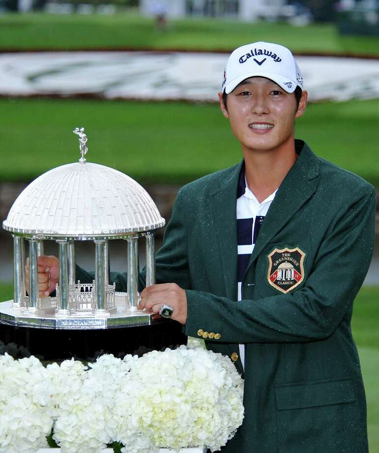 Danny Lee poses with the trophy after winning the Greenbrier Classic golf tournament at Greenbrier Resort in White Sulphur Springs, W.Va., Sunday, July 5, 2015. (AP Photo/Chris Tilley) Photo: AP / FR171192 AP