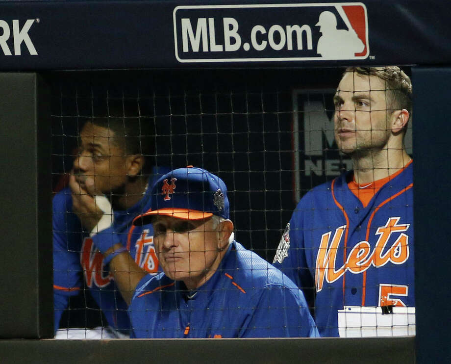 Mets manager Terry Collins watches with David Wright, right, and Curtis Granderson during the 11th inning of Game 5 of the World Series on Sunday night in New York. Photo: Matt Slocum — The Associated Press   / AP