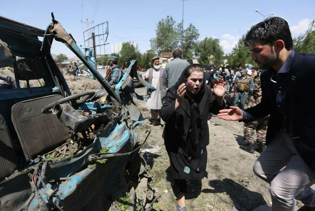 In this June 30 photo, an Afghan woman cries out at the site of a suicide attack on a NATO convoy in Kabul, Afghanistan.
