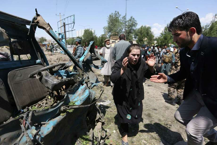 In this June 30 photo, an Afghan woman cries out at the site of a suicide attack on a NATO convoy in Kabul, Afghanistan. Photo: Rahmat Gul — The Associated Press   / AP