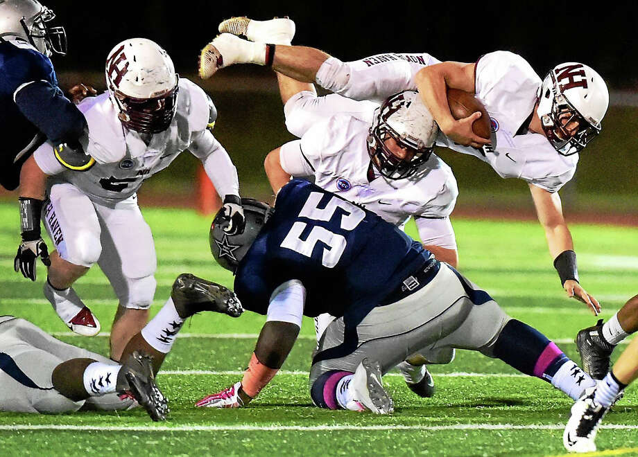 North Haven High School Running back Nicholas Ponzio dives for extra yardage against Hillhouse High School during a first quarter drive that ended in a North Haven touchdown this weekend. Photo: Peter Hvizdak - New Haven Register   / ?2015 Peter Hvizdak