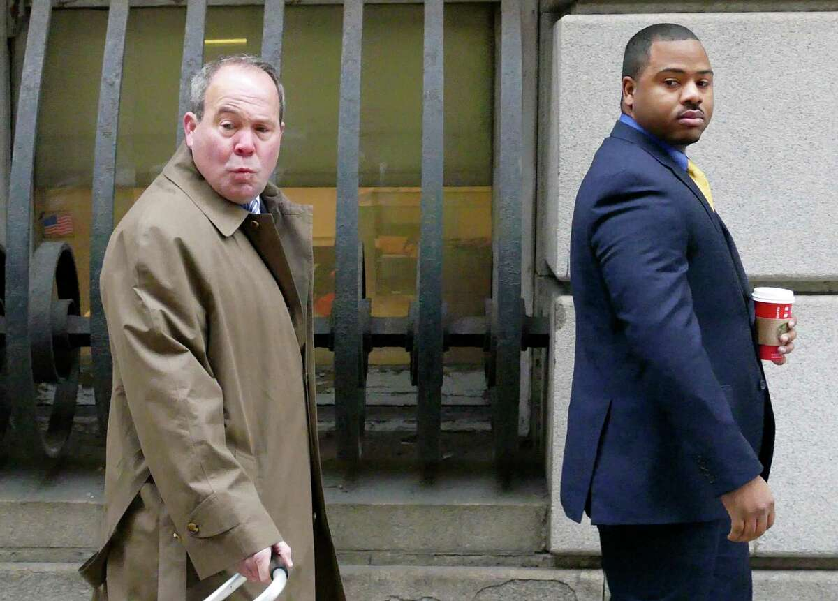 William Porter, right, one of six Baltimore city police officers charged in connection to the death of Freddie Gray, walks into a courthouse for jury selection in his trial, Monday, Nov. 30, 2015, in Baltimore. Porter faces charges of manslaughter, assault, reckless endangerment and misconduct in office.