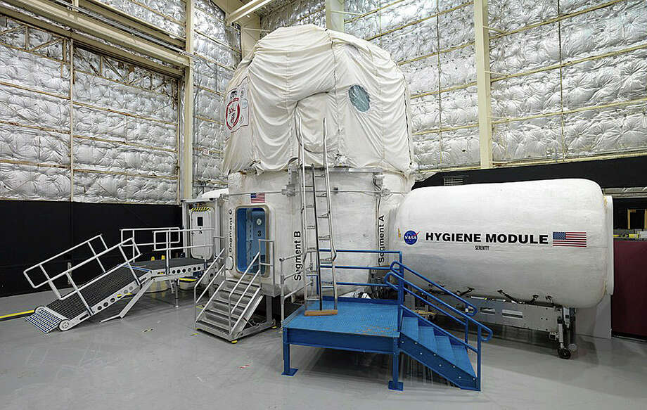 This Nov. 15, 2013 photo released by NASA shows the three-story Human Exploration Research Analog habitat at the Johnson Space Center in Houston. The space agency, which is contemplating a future journey to Mars, is working with a military laboratory at the submarine base in Groton, Conn., to measure how teams handle stress during month-long simulations of space flight. Photo: Bill Stafford/NASA Via AP   / NASA