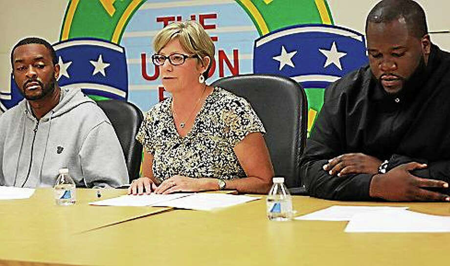 Left to right: CJTS employees James Corey, Paula Dillon and Peter Maylor. Photo: Elizabeth Regan — CTNewsJunkie