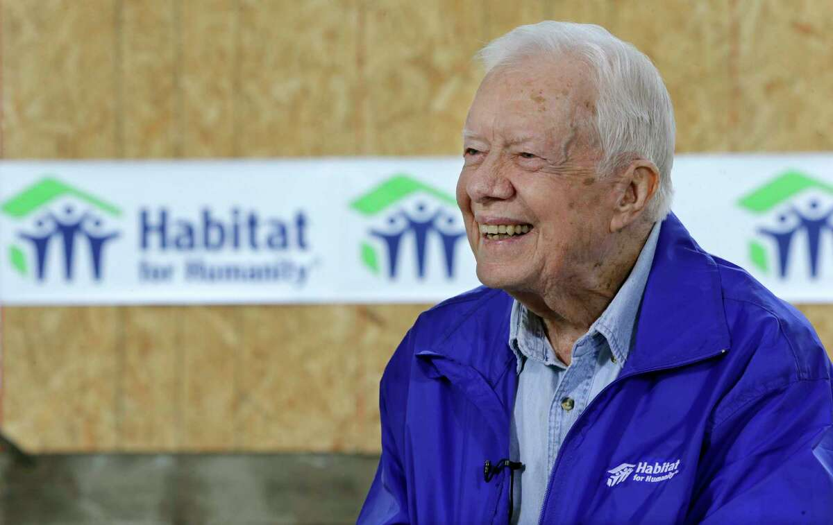 In this Nov. 1, 2015 photo, former President Jimmy Carter is interviewed at a Habitat for Humanity project site in Memphis, Tenn. Carter said it's too soon to tell whether treatment he received for his brain cancer has been effective, but that he hasn't been uncomfortable or ill while receiving rounds of immune-boosting drugs.