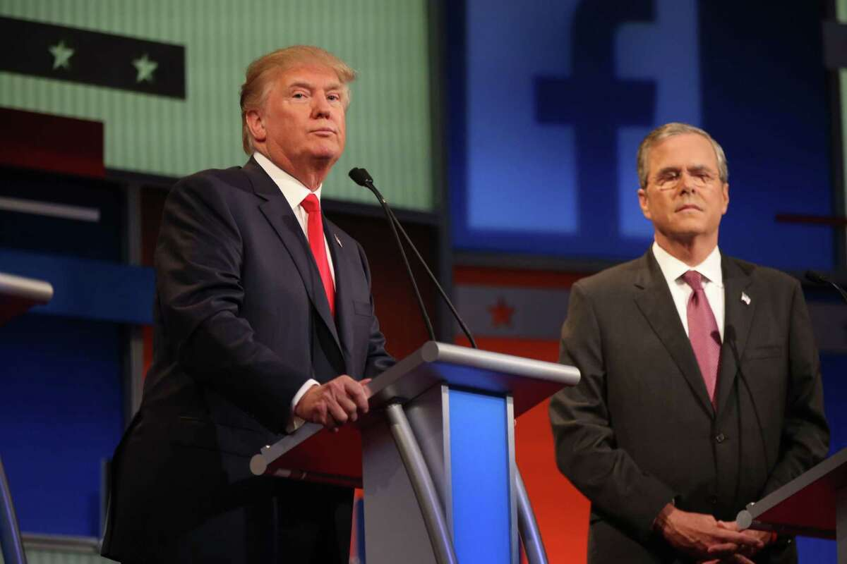 Republican presidential candidates, from left, Donald Trump and Jeb Bush take the stage Thursday.