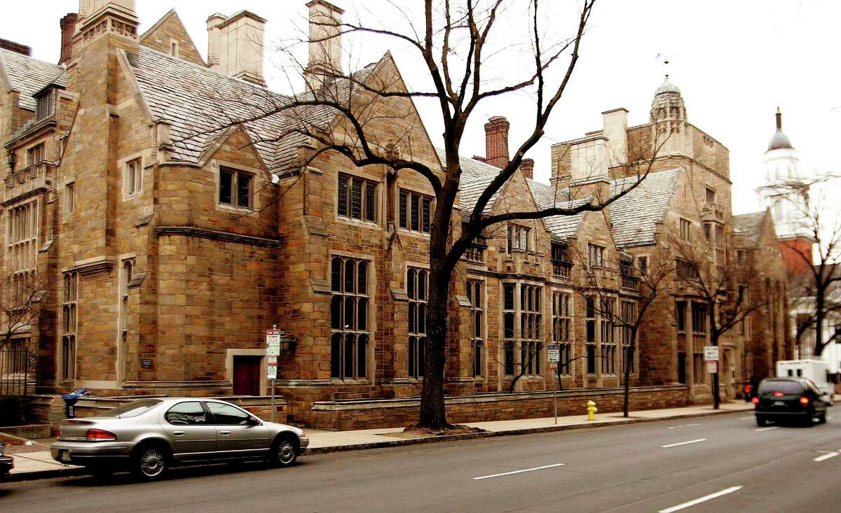 This Feb. 2, 2007 photo shows Calhoun College, one of 12 residential colleges housing undergraduates at Yale University in New Haven, Conn. There's also a push to strip the name of John C. Calhoun, a white supremacist, from the building.