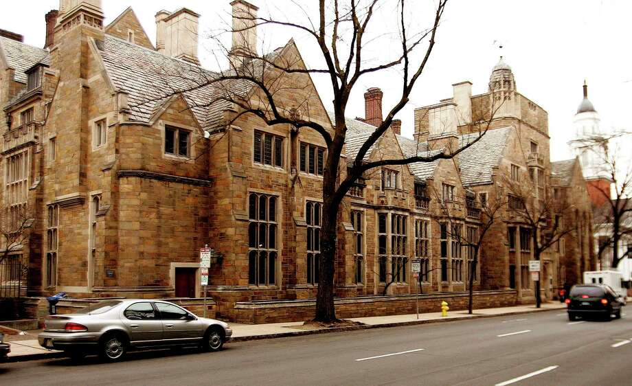 This Feb. 2, 2007 photo shows Calhoun College, one of 12 residential colleges housing undergraduates at Yale University in New Haven, Conn. There's also a push to strip the name of John C. Calhoun, a white supremacist, from the building. Photo: AP Photo/Bob Child, File   / AP