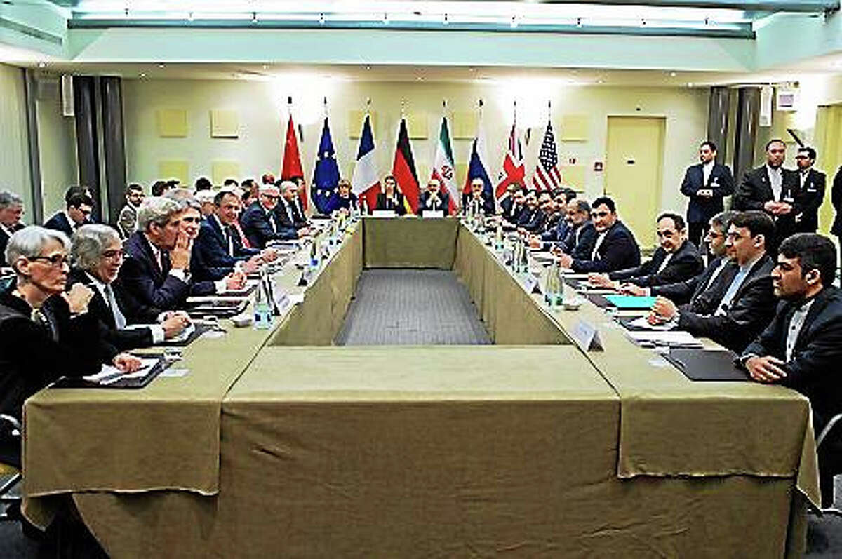 The ministers of foreign affairs of the United States, the United Kingdom, Russia, Germany, France, China, the European Union and Iran during negotiations in Lausanne, Switzerland on March 30, 2015.