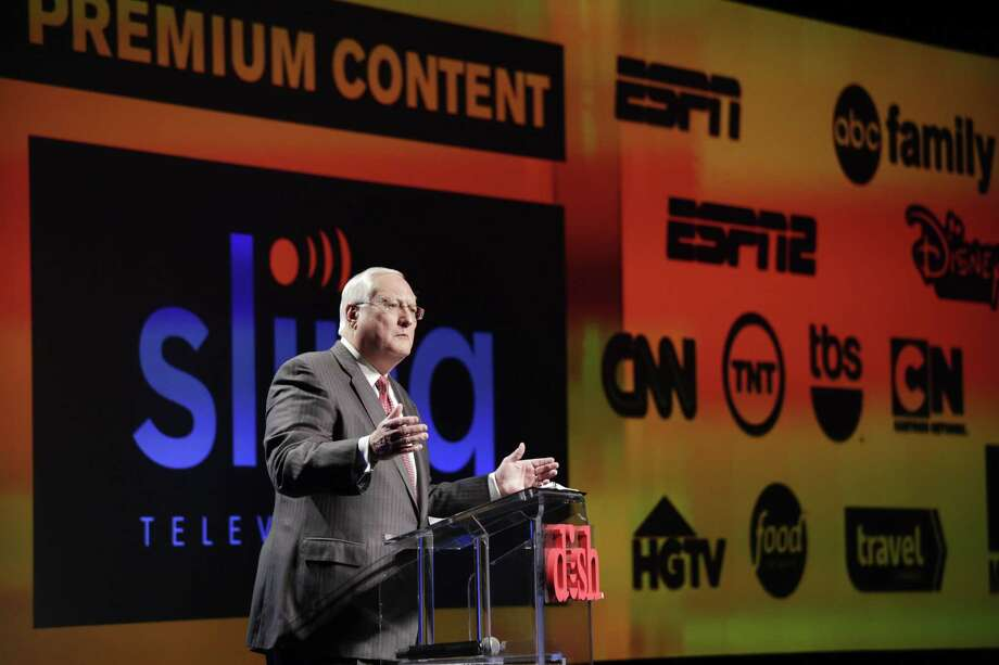 In this Jan. 5 photo, Joe Clayton, president and CEO of Dish Network, introduces the Sling TV, a live television streaming service, at a news conference at the International CES in Las Vegas. Photo: Jae C. Hong — The Associated Press   / AP