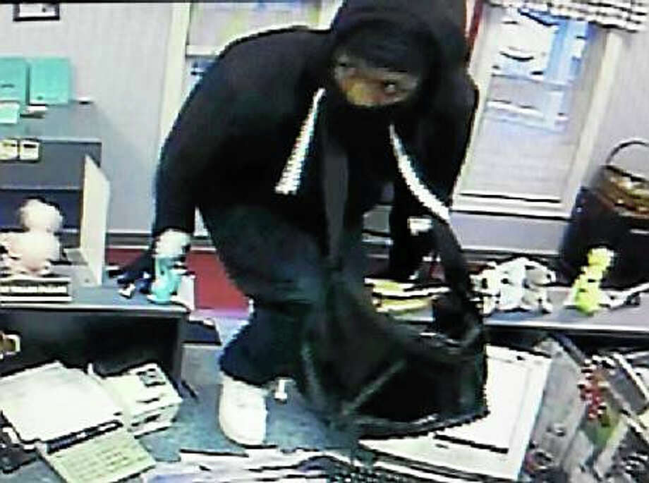 Police are looking for this man who they say robbed the Wallingford Municipal Federal Credit Union Wednesday afternoon. Photo: Wallingford Police Department