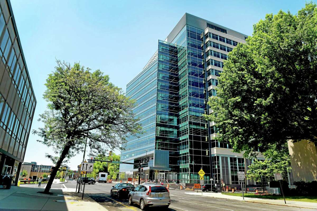 (Peter Hvizdak - New Haven Register) Alexion building at 100 College Street in New Haven, right, Friday, July 3, 2015.