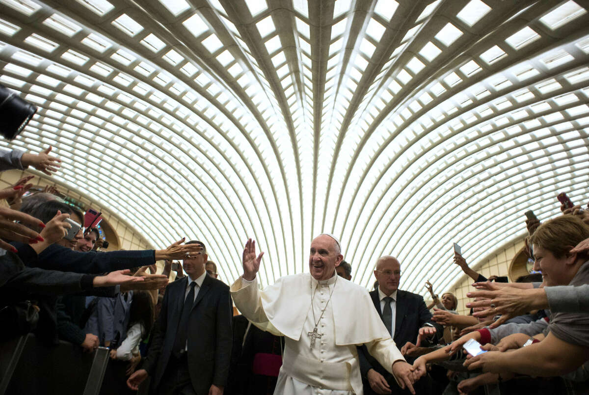 Pope Francis is cheered by faithful as he arrives to attend an audience with the representatives of the Union of Catholic Entrepreneurs, in the Pope Paul VI hall at the Vatican on Oct. 31, 2015.