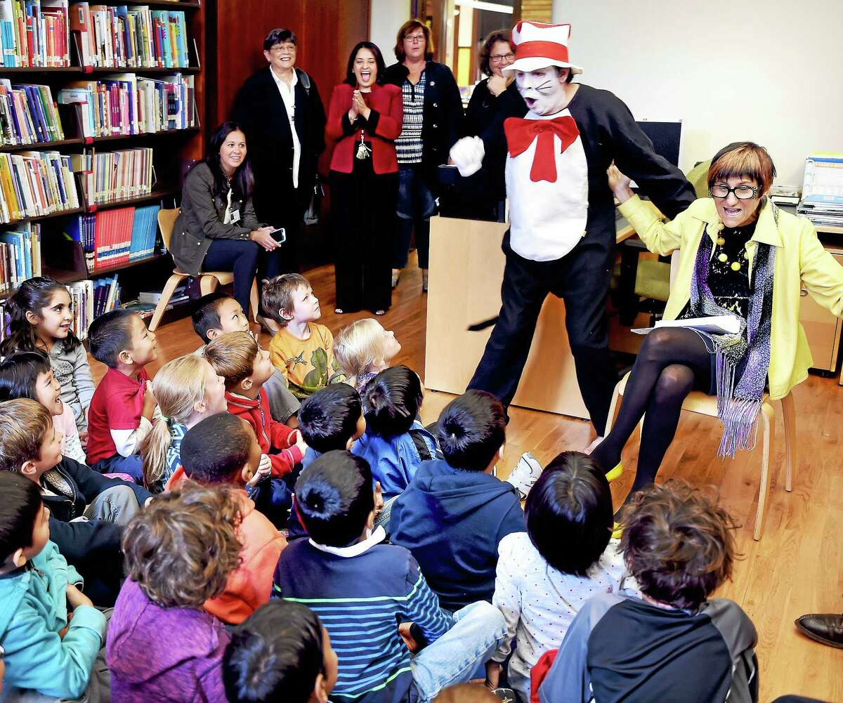 U.S. Rep. Rosa L. DeLauro, right, and her senior staffer Lou Mangini — dressed as the Cat in the Hat — surprise first-graders at Worthington Hooker Elementary School to kick off a youth reading program Monday in New Haven.