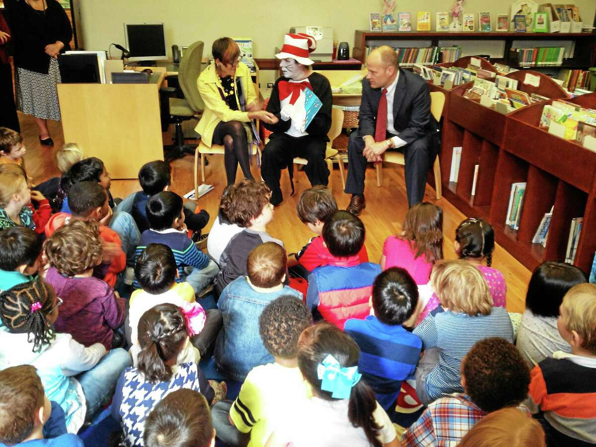 """U.S. Rep. Rosa DeLauro, D-3, at left, joined the 'Cat in the Hat' and new Haven Superintendent of Schools Garth Harries at Worthington Hooker School Monday to promote her """"Rosa's Readers"""" program, which challenges first graders to read 20 or more books with their families and teachers over the span of three months,"""