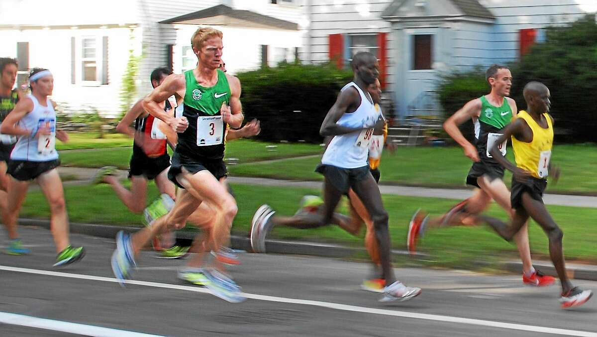 Matt Tegenkamp, shown here during his 2012 New Haven Road Race victory, is one of the favorites for Monday's race.
