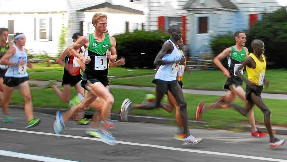Matt Tegenkamp, shown here during his 2012 New Haven Road Race victory, is one of the favorites for Monday's race. Photo: Peter Casolino — Register File Photo