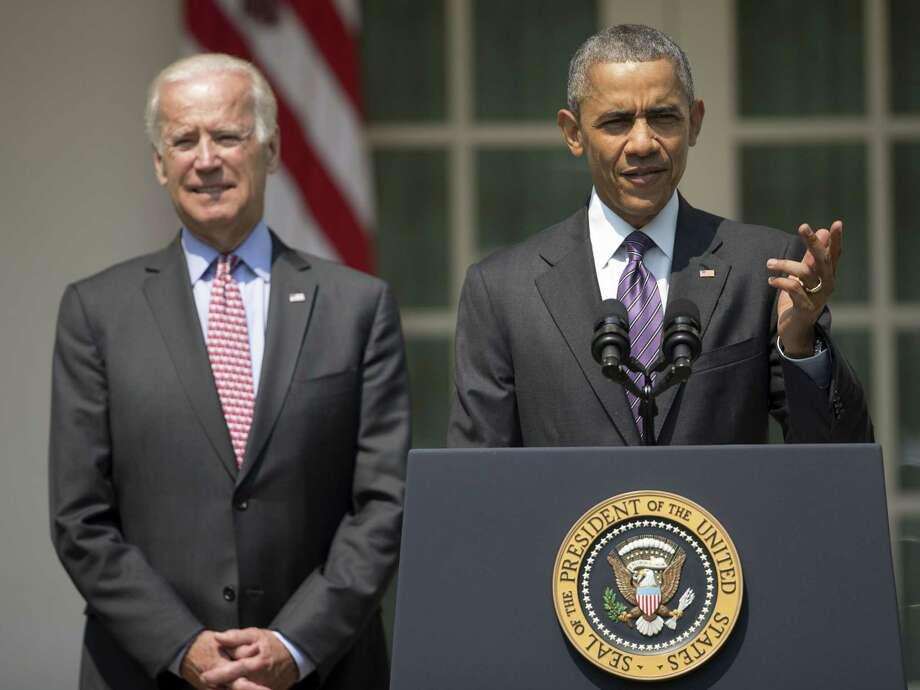 President Barack Obama, accompanied by Vice President Joe Biden, speaks in the Rose Garden of the White House in Washington Wednesday. Photo: Pablo Martinez Monsivais — The Associated Press   / AP