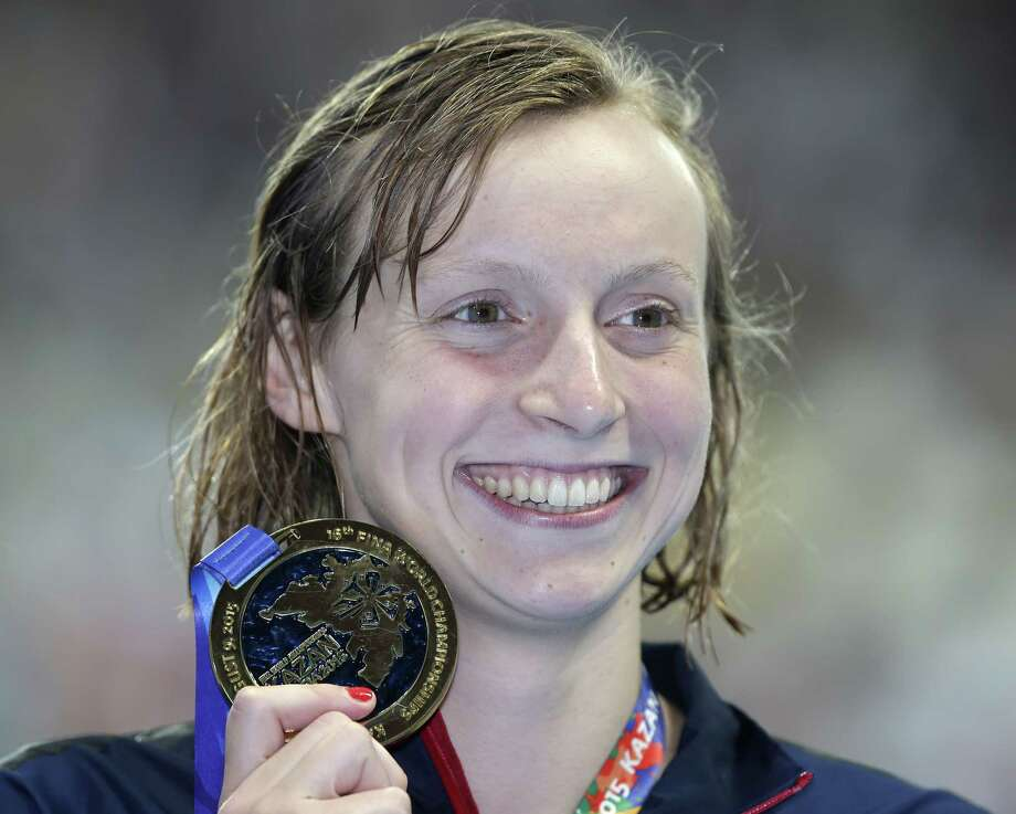 The United States' Katie Ledecky holds her gold medal Wednesday after winning the women's 200-meter freestyle final at the Swimming World Championships in Kazan, Russia. Photo: Michael Sohn — The Associated Press   / AP