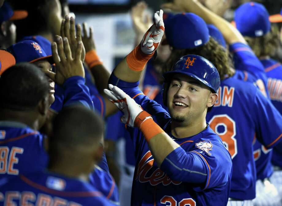 Mets rookie Michael Conforto celebrates his two-run home run during Wednesday's win over the Philadelphia Phillies in New York. Photo: Kathy Kmonicek — The Associated Press   / FR170189 AP