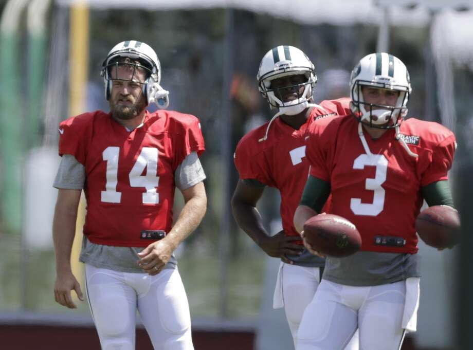 New York Jets quarterbacks Ryan Fitzpatrick (14), Geno Smith (7) and Jake Heaps (3) take part in drills during practice Wednesday in Florham Park, N.J. Photo: Frank Franklin II — The Associated Press   / AP