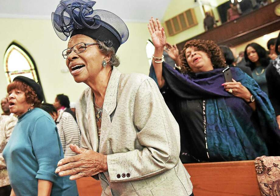 (Catherine Avalone - New Haven Register)   Deaconess Geraldine Poole, center, sings praise Sunday morning, October 19, 2014, on Laity Sunday at Varick Memorial A.M.E. Zion Church on Dixwell Avenue in New Haven. At right is Joyce Patton and Carol Smith, at left. The Methodist church celebrates Laity Sunday on the third Sunday in October recognizing the everyday and mission work by lay people. Photo: Journal Register Co. / New Haven RegisterThe Middletown Press