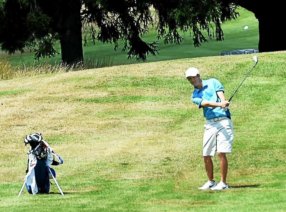 Nicklaus Harrington of Chaplin goes for the 18th green during the final round of the Northern Junior Golf Championships at New Haven Country Club on Wednesday.