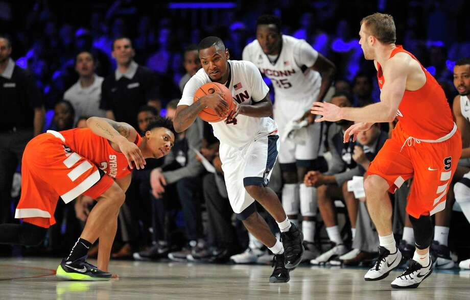 UConn guard Sterling Gibbs picks up a steal between Syracuse guards Malachi Richardson (23) and Trevor Cooney (10) during Thursday's game in the Bahamas. Photo: Brad Horrigan — The Associated Press   / The Courant