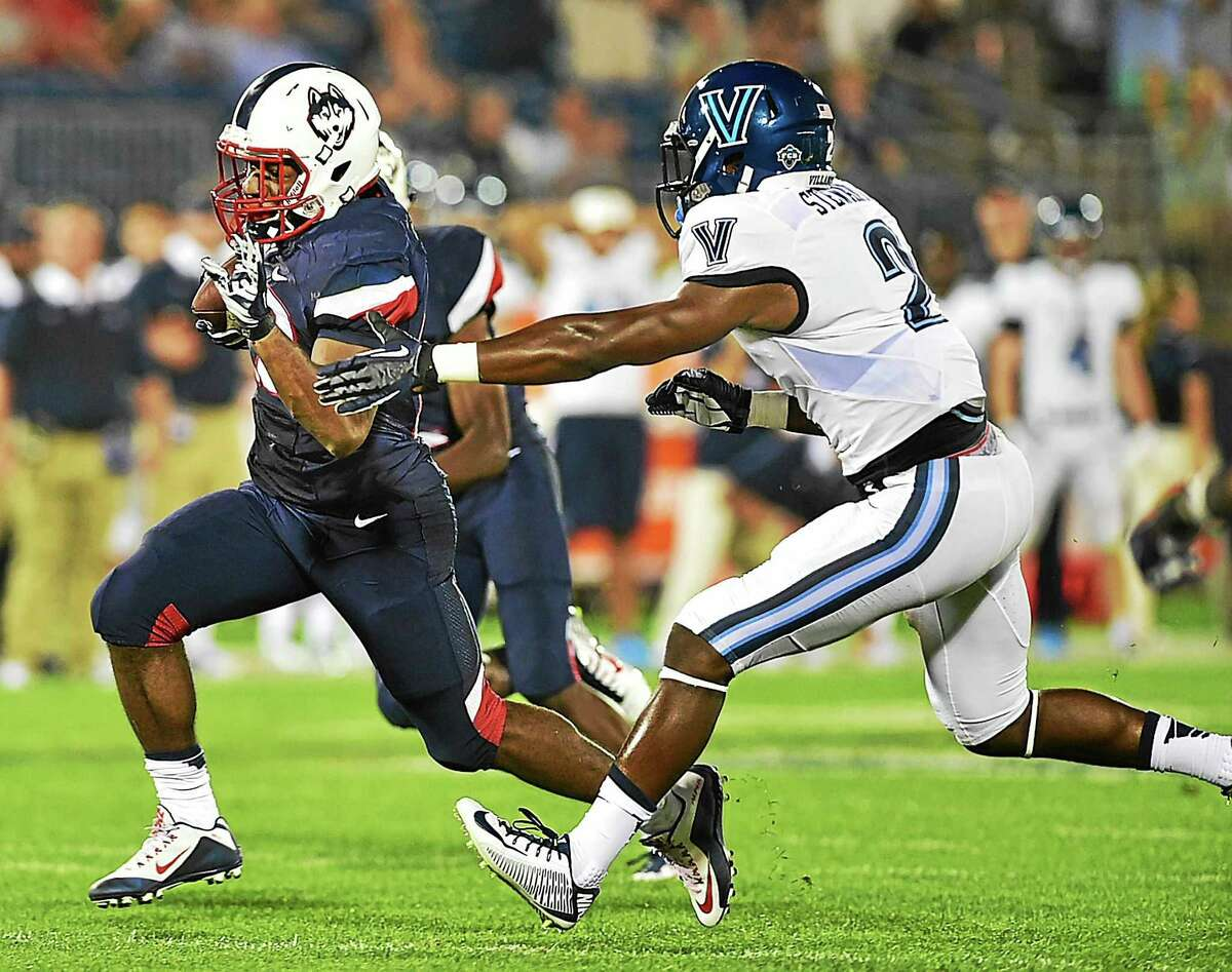 UConn's Arkeel Newsome breaks past Rasaan Stewart for a touchdown in the fourth quarter against Villanova on Thursday at Rentschler Field in East Hartford.