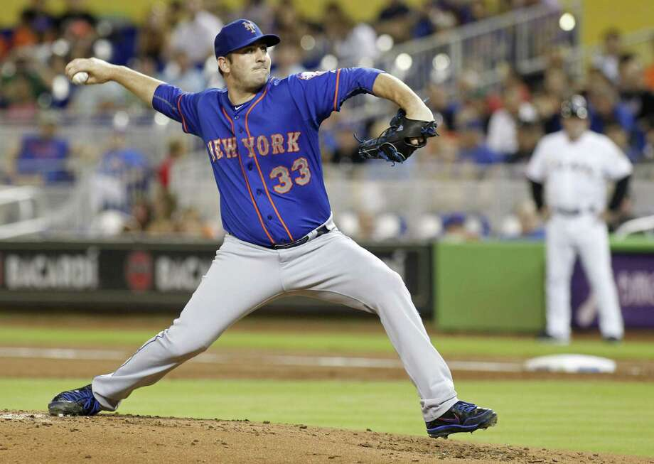 Matt Harvey delivers a pitch against the Marlins on Wednesday. Photo: Joe Skipper — The Associated Press   / FR171174 AP