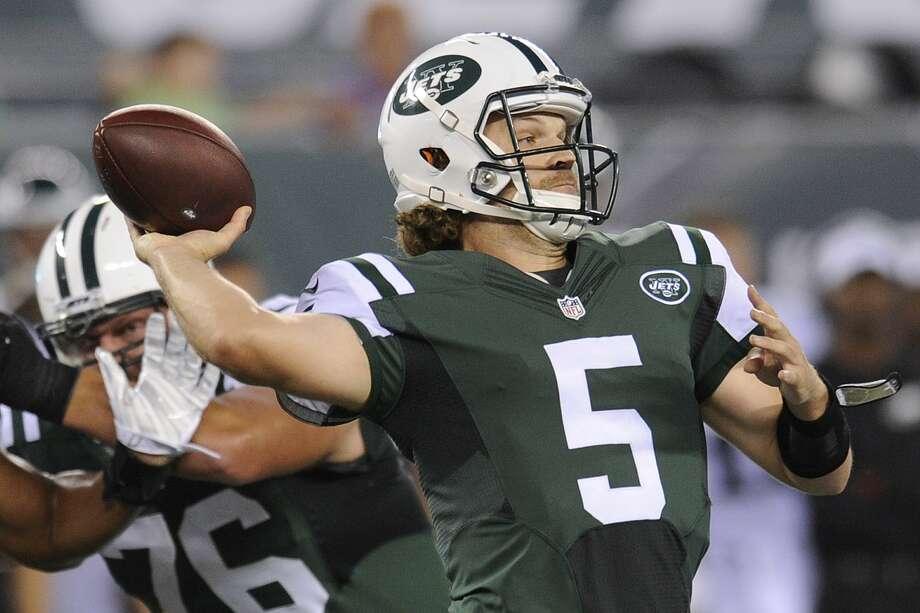 Jets quarterback Matt Flynn throws a pass during the first half of Thursday's preseason game against the Eagles. Photo: Bill Kostroun — The Associated Press   / FR51951 AP