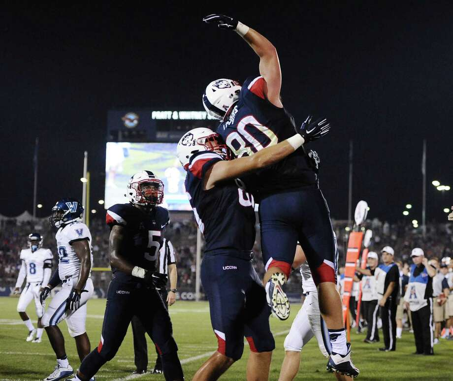 UConn tight end Tommy Myers, right, celebrates with Alec Bloom (86) after scoring a touchdown during the first half Thursday. Photo: Jessica Hill — The Associated Press   / FR125654 AP
