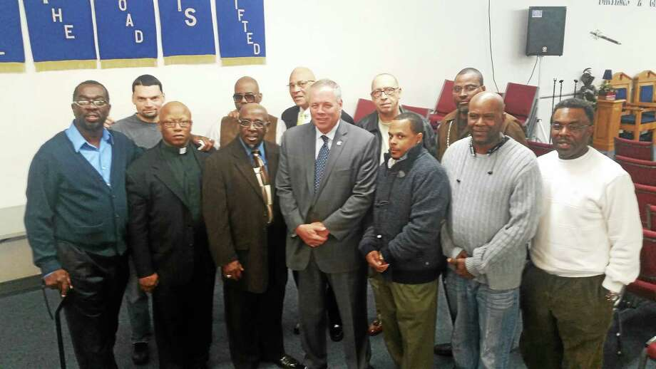 State Department of Correction Commissioner Scott Semple with Apostle Eugene Brunson and Wayfaring Ministries Inc. reentry program staff, supporters and program participants. Photo: Shahid Abdul-Karim - New Haven Register