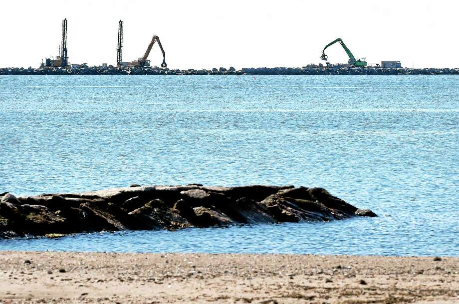 Work proceeds on the breakwater for New Haven Harbor recently. Photo: Arnold Gold — New Haven Register