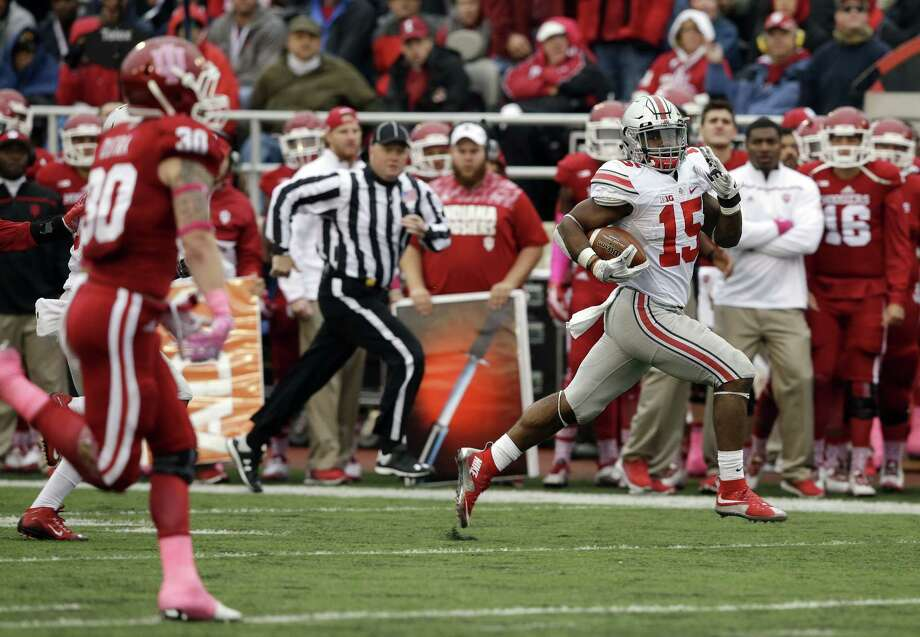 Ohio State's Ezekiel Elliott (15) runs 55 yards for a touchdown during the second half Saturday against Indiana. Photo: Darron Cummings — The Associated Press   / AP