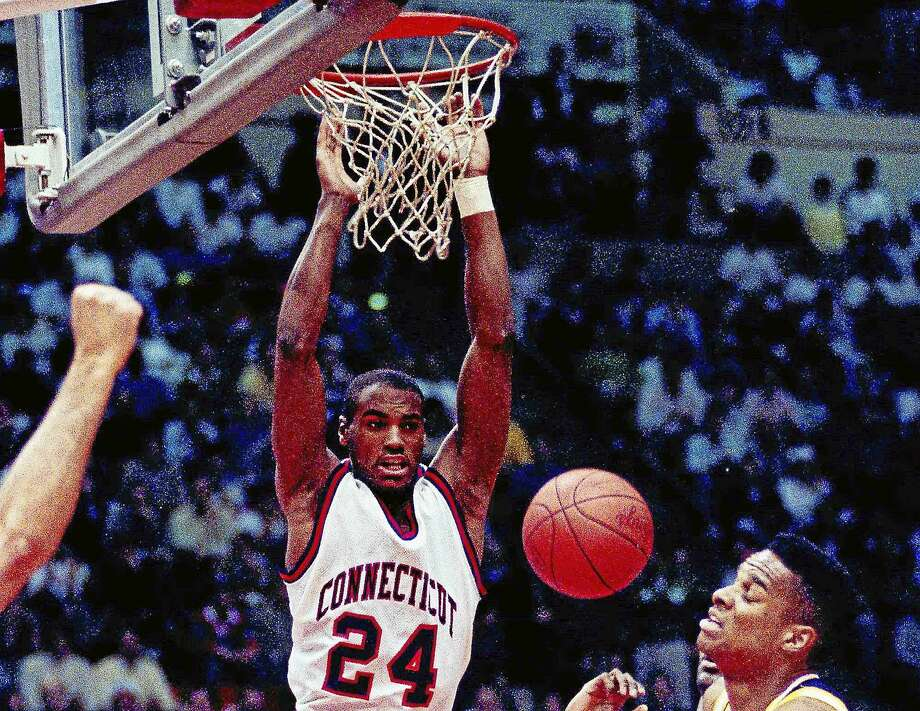 Scott Burrell, expected to be the next men's basketball coach at Southern Connecticut State, dunks the ball during UConn's second-round NCAA tournament game against California in Hartford on March 17, 1990. Photo: Bob Child — The Associated Press File Photo   / 1990 AP