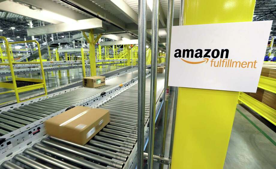 A package moves along a conveyer belt during a media tour of the Amazon.com fulfillment center in DuPont, Wash. Photo: AP Photo/Ted S. Warren/File   / AP
