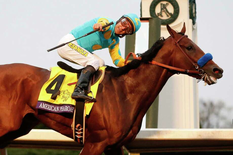 American Pharoah, with Victor Espinoza up, wins the Breeders' Cup Classic horse race at Keeneland race track on Oct. 31, 2015 in Lexington, Ky. Photo: AP Photo/Brynn Anderson   / AP
