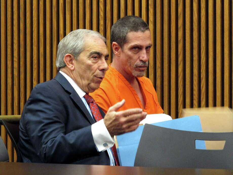 Bobby Hernandez, right, listens to defense attorney Ralph DeFranco in Cuyahoga County Common Pleas Court before pleading not guilty to kidnapping and other charges on Tuesday, Dec. 1, 2015, in Cleveland. Authorities allege Hernandez took his 5-year-old son from an Alabama home in 2002 and created a life for them in Ohio under new identities, a ruse discovered through discrepancies with the boy's Social Security number as he began the college application process. Photo: AP Photo/Kantele Franko    / AP