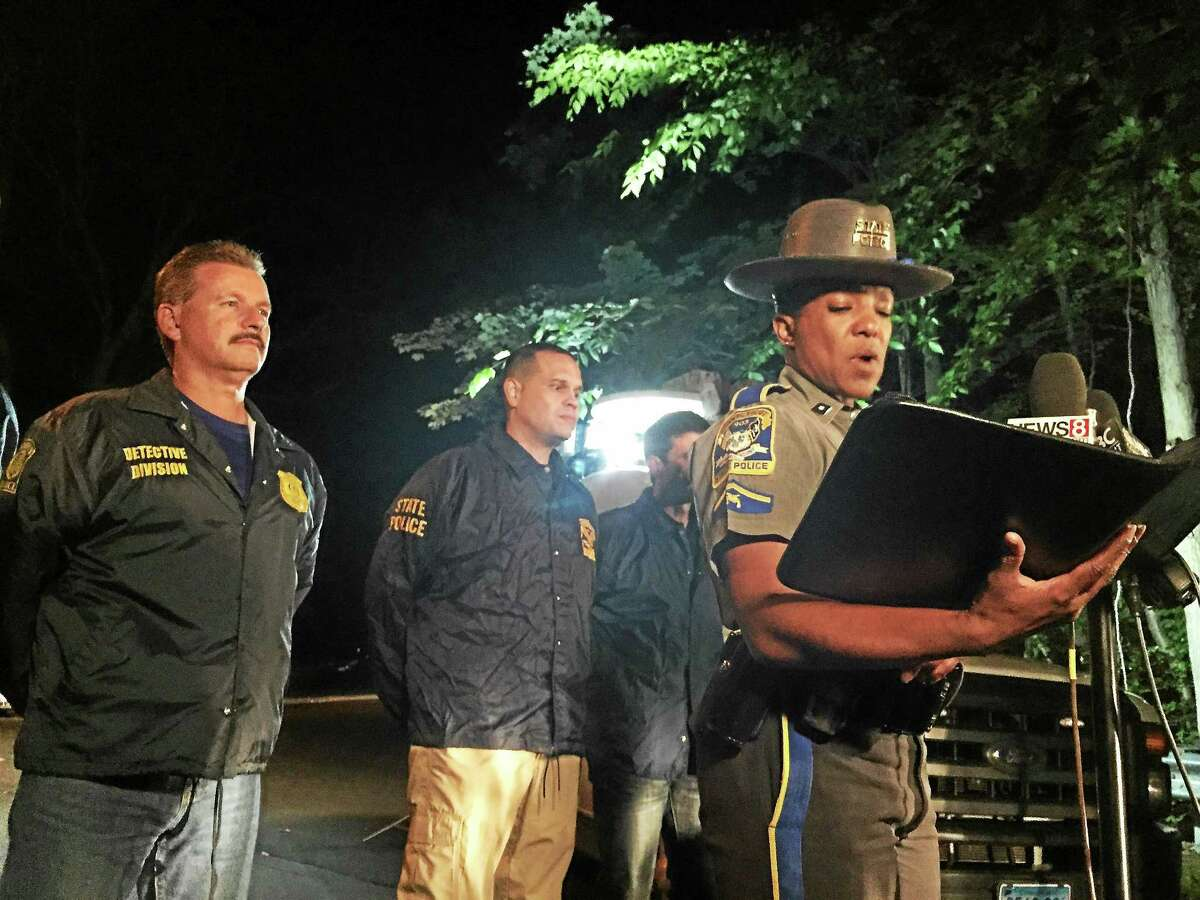 Connecticut State Police spokesperson and Trooper First Class Kelly Grant address media during a press conference Saturday night near the scene of an explosion in Hamden.