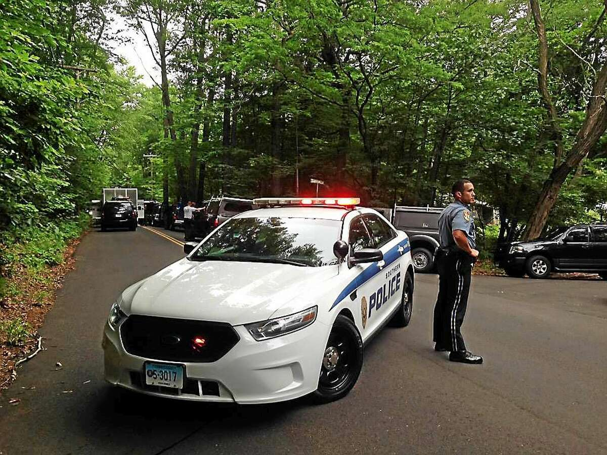 A police car blocks Wintergreen Avenue in Hamden near the site of a reported explosion and discovery of a body.